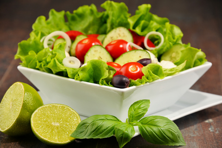 vegetable salad: Composition with vegetable salad bowl. Balanced diet. Stock Photo