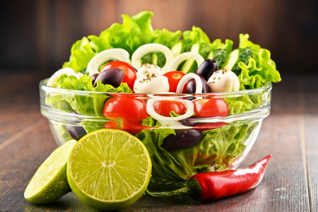 salad bowl: Composition with vegetable salad bowl. Balanced diet. Stock Photo