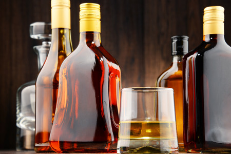distilled alcohol: Composition with bottles of assorted alcoholic beverages.