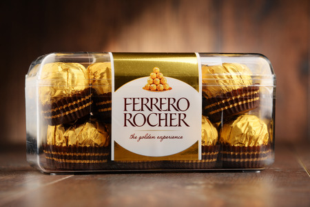 ferrero: POZNAN, POLAND - OCT 13, 2016: Ferrero Rocher premium chocolate sweets produced by the Italian chocolatier Ferrero SpA. are sold in over 40 countries in amount of about 3.6 billion a year