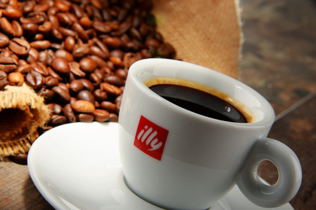 founded: POZNAN, POLAND - APRIL 29, 2016: Illy is an Italian coffee roasting company that specializes in the production of espresso. Founded by Francesco Illy in 1933. Editorial