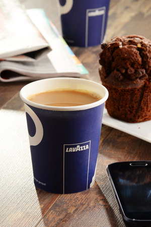 POZNAN, POLAND - APRIL 28, 2016: Lavazza is an Italian manufacturer of coffee products It was founded in Turin in 1895 by Luigi Lavazza. Редакционное