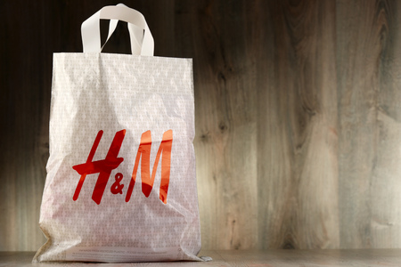 hm: POZNAN, POLAND - NOV 3, 2016: H & M Hennes & Mauritz AB is a Swedish multinational clothing-retail company, It operates over 4,000 stores  in 62 countries worldwide