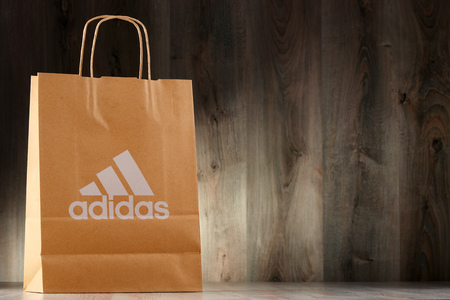 ag: POZNAN, POLAND - NOV 3, 2016: Adidas AG headquartered in Herzogenaurach, Bavaria, Germany is the largest sportswear manufacturer in Europe and the second biggest in the world
