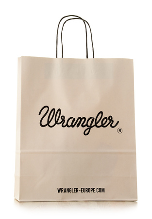 headquartered: POZNAN, POLAND - NOV 3, 2016: Wrangler is an American manufacturer of jeans and other clothing items, owned by the VF Corporation headquartered in Greensboro, North Carolina, USA