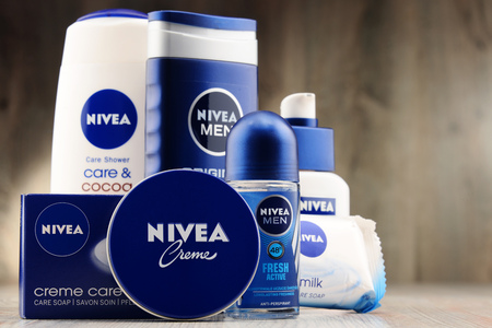 specializes: POZNAN, POLAND - DEC 2, 2016: Nivea is a German personal care brand that specializes in skin- and body-care products. It is owned by Beiersdorf Global AG headquartered in Hamburg.