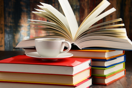 Composition with books and cup of coffee.