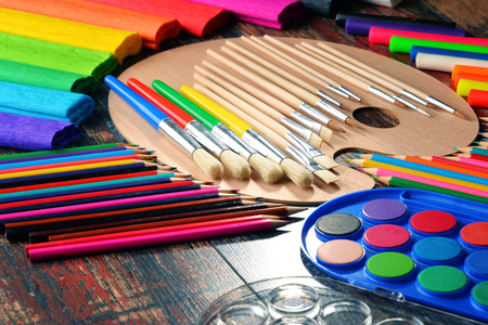 elementary schools: Composition with school accessories for painting and drawing.