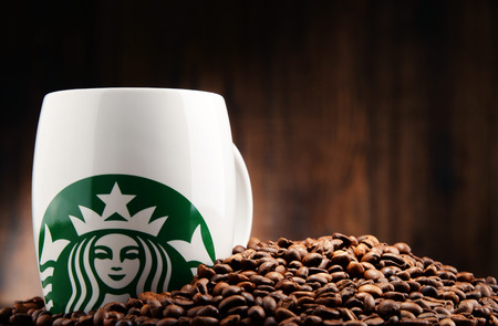 POZNAN, POLAND - DEC 15, 2016: Starbucks, coffee company and coffeehouse chain, founded in Seattle, Wa. USA, in 1971; now the largest business of this kind in the world operates 23,450 locations