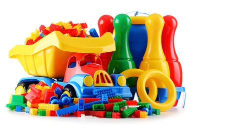 Composition with colorful plastic children toys isolated on white. Stock Photo