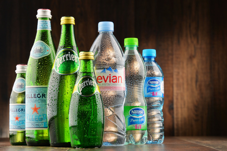 water bottles: POZNAN, POLAND - JAN 18, 2017: Global bottled water sales have increased dramatically over the past decades. It is estimated that around 200 billion bottles are consumed yearly all over the world Editorial