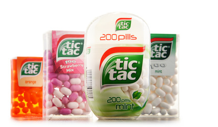 ferrero: POZNAN, POLAND - JAN 19, 2017: Tic Tac is a brand of hard mints, manufactured by the Italian confectioner Ferrero, available in a variety of flavors in over 100 countries