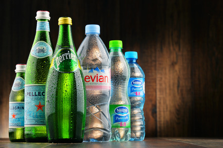 dramatically: POZNAN, POLAND - JAN 18, 2017: Global bottled water sales have increased dramatically over the past decades. It is estimated that around 200 billion bottles are consumed yearly all over the world Editorial