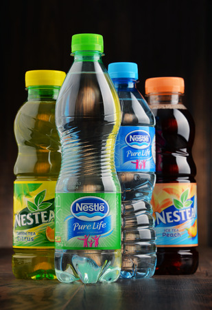 transnational: POZNAN, POLAND - JAN 18, 2017: Nestle is a transnational food and drink company headquartered in Vevey, Vaud, Switzerland. Among its 8,000 brands are bottled water and very popular nestea drinks Editorial