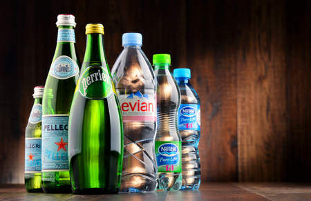 increased: POZNAN, POLAND - JAN 18, 2017: Global bottled water sales have increased dramatically over the past decades. It is estimated that around 200 billion bottles are consumed yearly all over the world Editorial