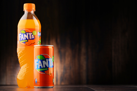 carbonated: POZNAN, POLAND - JAN 20, 2017: Fanta is a global brand of fruit-flavored carbonated soft drinks created by The Coca-Cola Company in Germany in 1940