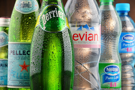zvýšil: POZNAN, POLAND - JAN 18, 2017: Global bottled water sales have increased dramatically over the past decades. It is estimated that around 200 billion bottles are consumed yearly all over the world Redakční