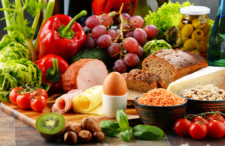 food products: Composition with variety of organic food products on kitchen table