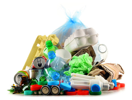 Recyclable garbage consisting of glass, plastic, metal and paper isolated on white