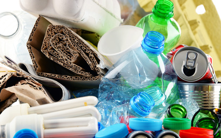 Recyclable garbage consisting of glass, plastic, metal and paper.