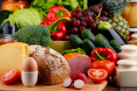 variety: Variety of organic food including vegetables fruit bread dairy and meat. Balanced diet.