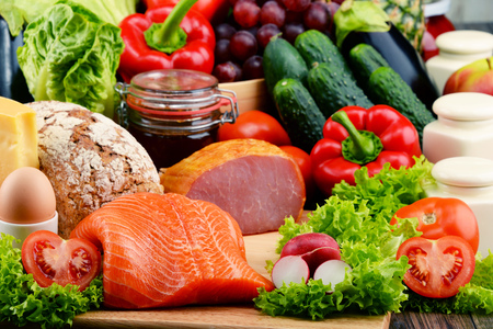 meat diet: Variety of organic food including vegetables, fruit, bread, dairy and meat. Balanced diet. Stock Photo