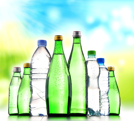 Different sorts of bottles containing mineral water isolated on white