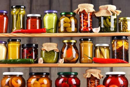 Jars with variety of pickled vegetables. Preserved food