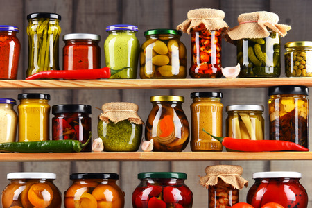 Jars with variety of pickled vegetables. Preserved food Stock fotó - 72511953
