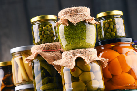 Jars with variety of pickled vegetables. Preserved food
