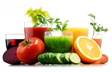 Glasses with fresh organic vegetable and fruit juices isolated on white. Detox diet