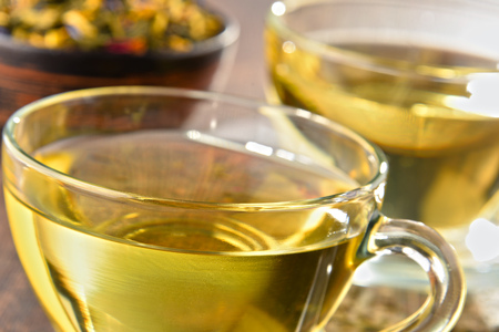 sencha tea: Composition with cup of tea and bowls of tea leaves. Stock Photo