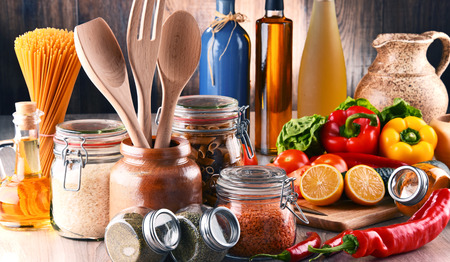 food products: Composition with assorted food products and kitchen utensils on the table