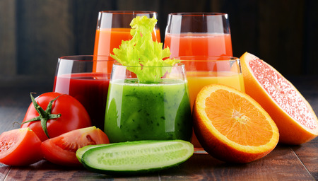 Glasses with fresh organic vegetable and fruit juices. Detox diet Stock Photo