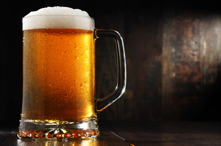 pilsner beer: Composition with glass of beer on wooden background. Stock Photo