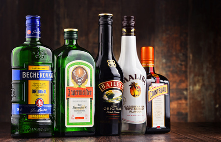baileys: POZNAN, POLAND - MAR 16, 2016: Historical descendants of herbal medicines, liqueurs are drinks made from distilled spirit flavored with fruit, cream, herbs, spices, flowers or nuts and added sugar