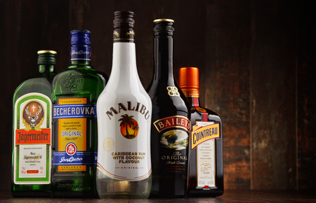 POZNAN, POLAND - MAR 16, 2016: Historical descendants of herbal medicines, liqueurs are drinks made from distilled spirit flavored with fruit, cream, herbs, spices, flowers or nuts and added sugar