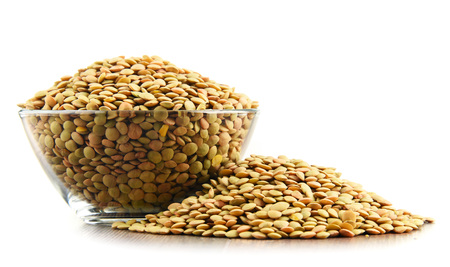 Composition with bowl of lentils isolated on white background 스톡 콘텐츠