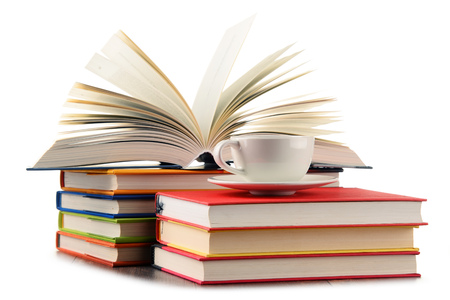 Composition with books and cup of coffee isolated on white.