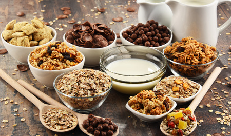sorts: Composition with different sorts of breakfast cereal products. Stock Photo