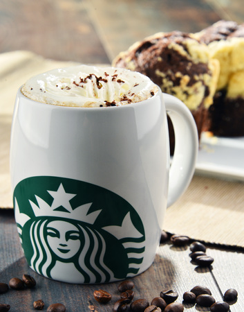 POZNAN, POLAND - MAR 24, 2017: Starbucks, coffee company and coffeehouse chain, founded in Seattle, Wa. USA, in 1971; now the largest business of this kind in the world operates 23,450 locations