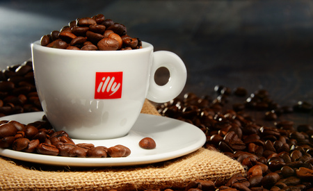 specializes: POZNAN, POLAND - APRIL 29, 2016: Illy is an Italian coffee roasting company that specializes in the production of espresso. Founded by Francesco Illy in 1933. Editorial