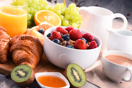 Breakfast served with coffee, orange juice, croissants, cereals and fruits. Balanced diet. Stock Photo - 80753990