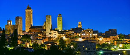 tourist site: Panoramic view of San Gimignano in Tuscany, Italy by night. UNESCO World Heritage Site