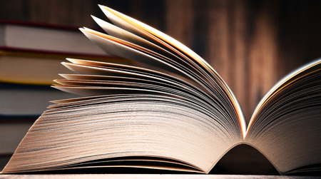 glossary: Composition with open book on the table. Stock Photo