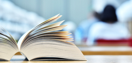 glossary: Books lying on the table in the public library. Stock Photo
