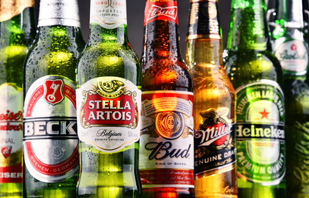 widely: POZNAN, POLAND - JULY 21, 2017: beer is the worlds most widely consumed alcoholic beverage; its global market is largely dominated by brands of several multinational corporations