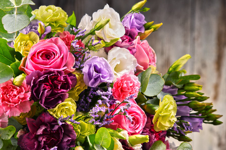 Composition with bouquet of flowers.