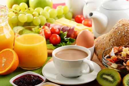 Breakfast served with coffee, orange juice, egg, rolls and fruits. Balanced diet. Stock Photo - 83491221