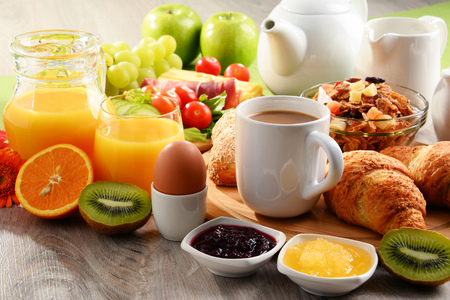 Breakfast served with coffee, orange juice, egg, rolls and fruits. Balanced diet. Stock Photo - 83530265
